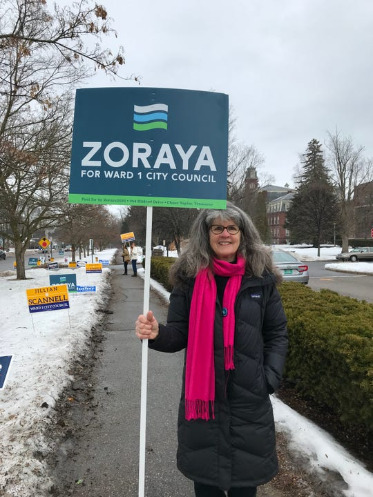 Caryn Long holds a sign in support of Progressive candidate Zoraya Hightower at the Mater Christi School on Town Meeting Day. March 3, 2020.