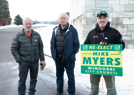 From left to right: Winooski school board president Mike Decarreau,  Winooski Charter Commission member Doug Johnson, and incumbent Winooski city councilor Mike Myers greet voters outside the Winooski Senior Center as polls open on Town Meeting Day, March 3, 2020.