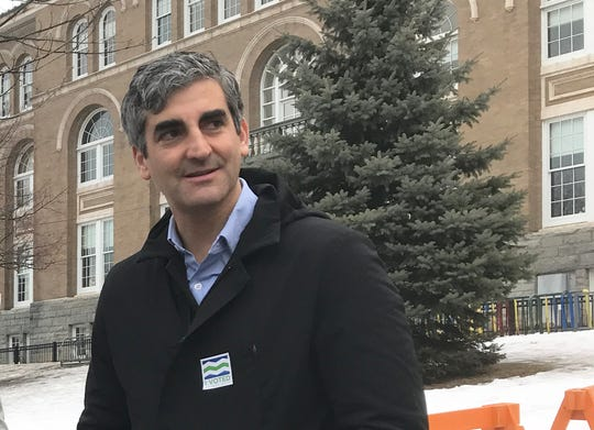 Burlington Mayor Miro Weinberger watches the arrival of Ward Six voters at Edmunds Elementary School on Town Meeting Day, March 3, 2020.