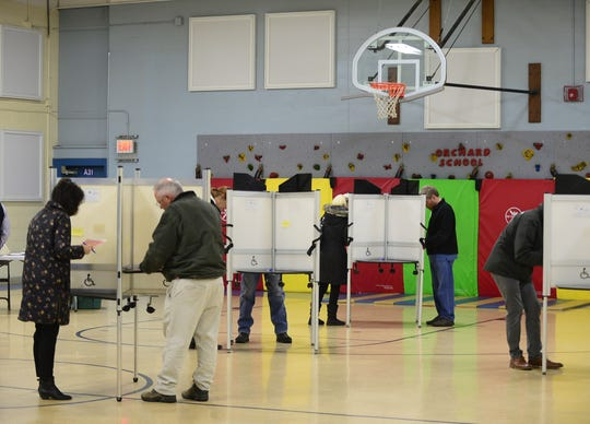 Voters fill out their ballots at Orchard School in South Burlington on Tuesday morning, March 3, 2020. People lined up to vote as the polling station opened at 7 a.m.