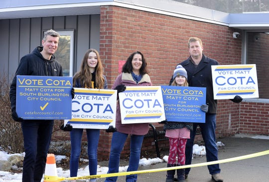 From left, Roland, Lily and Lisa  Goreneveld, as well as Nia and Tom Chittenden, campaign for South Burlington City Council candidate Matt Coat outside of Orchard School on Tuesday morning, March 3, 2020.