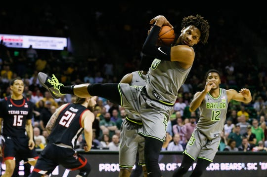 Mar 2, 2020; Waco, Texas, USA; Baylor Bears forward Freddie Gillespie (33) grabs the rebound against the Texas Tech Red Raiders during the first half at Ferrell Center. Mandatory Credit: Raymond Carlin III-USA TODAY Sports