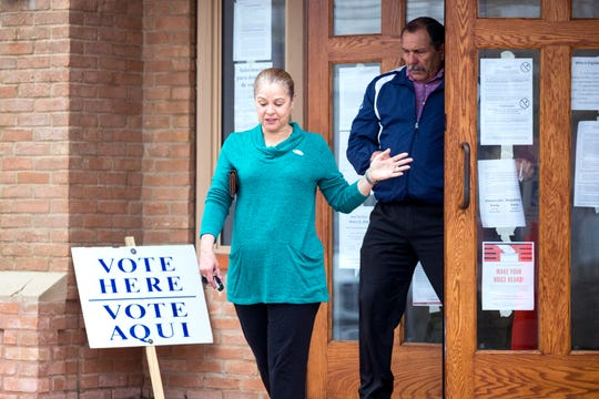 Voters exits Grace Presbyterian Church after voting on Tuesday, March 3, 2020.