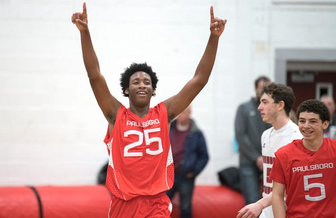 Paulsboro's Terren Carlson raises his arms as he celebrates Paulsboro's 34-29 victory over Haddon Township in the South Jersey Group 1 opening round boys basketball playoff game played at Haddon Township High School on Monday, March 2, 2020.
