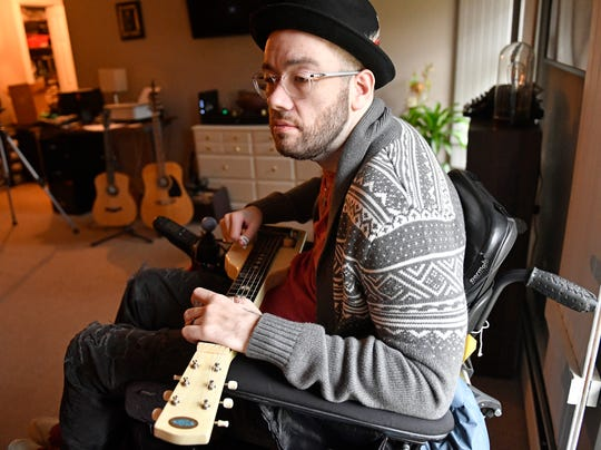 """Ryan """"Gooch"""" Nelson plays a song from his latest album """"Outside the Window"""" at his home in Pilesgrove. Gooch was in a car accident 16 years ago that left him a quadriplegic."""