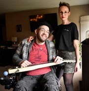 """Ryan """"Gooch"""" Nelson and his fiancee Brianna Bowers pose for a photo at their home in Pilesgrove. Gooch was in a car accident 16 years ago that left him a quadriplegic."""