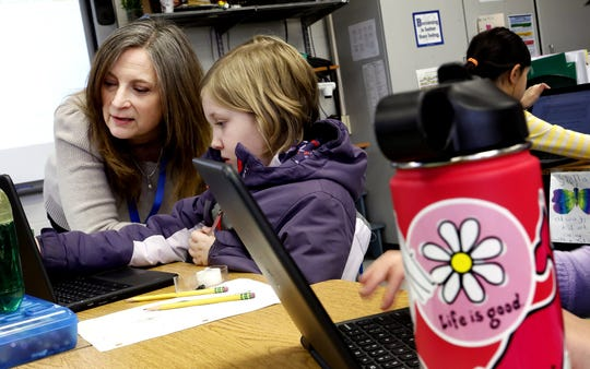 Erica Hecker Cassingham Elementary School counselor gives some assistance to Emersom Kempton 9 as she fills out the Panorama survey that is designed to measure students social and emotional health February 27, 2020.More school districts are turning to surveys to gauge the emotional health of their students.[Eric Albrecht/Dispatch]