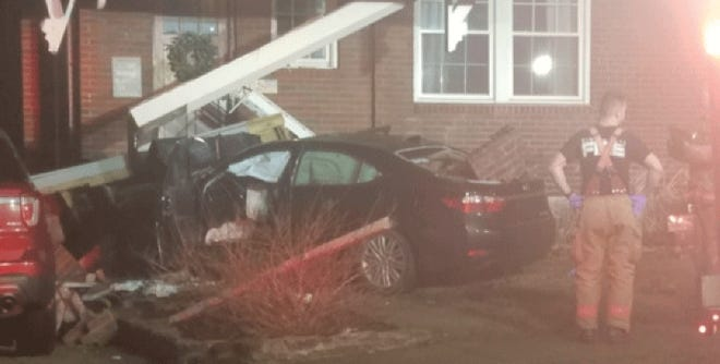 A car reported stolen crashed into a house on East McMillan Street in East Walnut Hills early Tuesday, sending two people inside the car to the hospital, Cincinnati police said. No one inside the home was hurt.