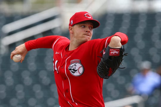 Cincinnati Reds starting pitcher Sonny Gray throws a pitch against the Los Angeles Dodgers during the first inning of a spring training baseball game Monday, March 2, 2020, in Goodyear, Ariz.