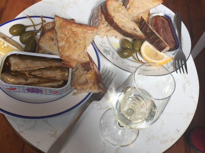 Grilled bread and tinned fish with wine from Mom'n'em coffeeshop in Camp Washington