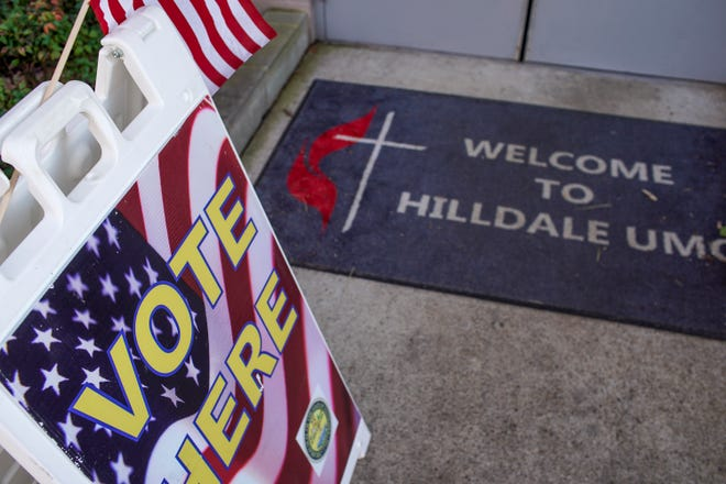 A voting sign with American flag is propped up in front of the entrance door at Hilldale United Methodist Church in Clarksville, Tenn., on Tuesday, March 3, 2020.