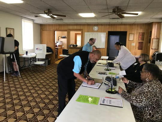 Calvin Board, 57, signs up to vote as polls opened at Bethel United Methodist Church on Fort Campbell Boulevard in north Clarksville on Tuesday, March 2, 2020.