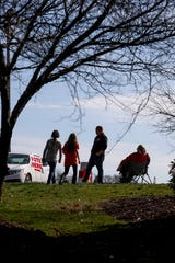 Jeff Bryant, who is running for Highway Supervisor, stands atop the hill leading to a polling location with his mom, Debbie Bryant, right, and daughter, Riley Bryant, center left, and her friend Gwen Devine, 10, left, at Hilldale United Methodist Church in Clarksville, Tenn., on Tuesday, March 3, 2020.