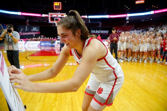 North Scott's Grace Boffeli places her schools name on the bracket after beating CCA during the quarterfinal round of the Iowa Girls' State Basketball Tournament at Wells Fargo Arena Tuesday, March 3, 2020.