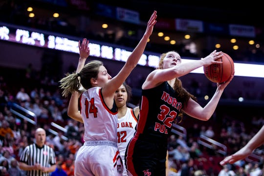 North Polk's Maggie Phipps attempts to shoot as Red Oak's Allie West defends during the Iowa girls' state basketball tournament quarterfinal game between North Polk and Red Oak on Monday, March 2, 2020, at Wells Fargo Arena in Des Moines.
