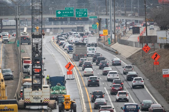 Traffic backs in the construction zone on I-75 near 9 Mile Road in Hazel Park on Monday as work continues on removing bridges along that section of highway.