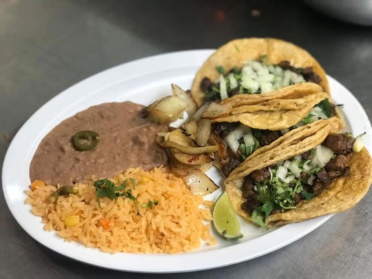 Taco's served with rice and beans at Jose's Tacos.