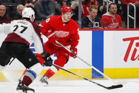 Mar 2, 2020; Detroit, Michigan, USA; Detroit Red Wings right wing Anthony Mantha (39) gets defended by Colorado Avalanche defenseman Ryan Graves (27) during the second period at Little Caesars Arena. Mandatory Credit: Raj Mehta-USA TODAY Sports