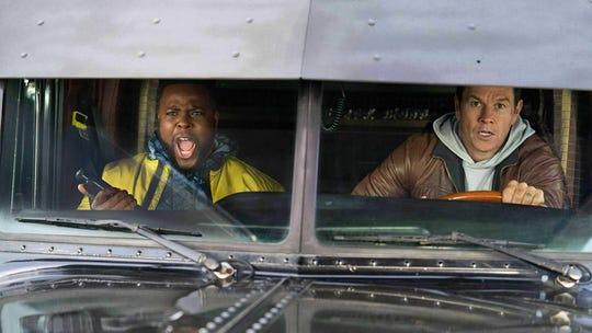 """Winston Duke (left) and Mark Wahlberg (right) star in """"Spenser Confidential."""""""