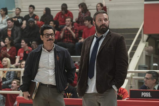 "Al Madrigal and Ben Affleck in ""The Way Back."""