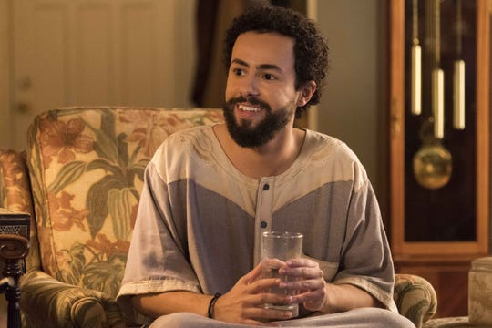 """This image released by Hulu shows Ramy Youssef in a scene from """"Ramy."""" Youssef was nominated for a Golden Globe for best actor in a comedy series."""
