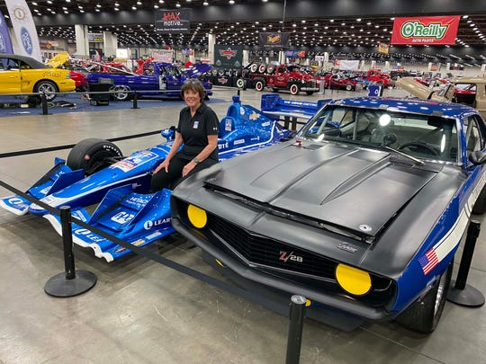 Racing legend Lyn St. James with a modern Indycar and 1969 Camaro Trans Am at Autorama. She'll be racing the Camaro on Belle Isle this May.