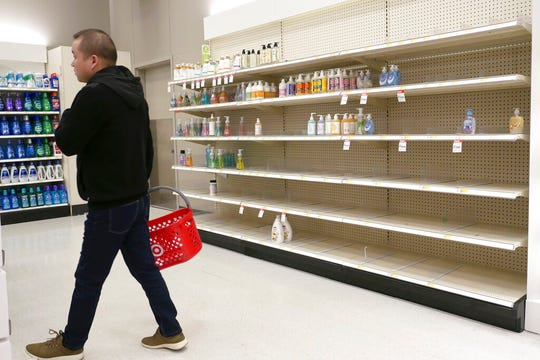 Shelves that held hand sanitizer and hand soap are mostly empty at a Target in Jersey City, N.J., Tuesday, March 3, 2020. Fear of the coronavirus has led people to stock up on hand sanitizer, leaving store shelves empty and online retailers with sky-high prices set by those trying to profit on the rush.