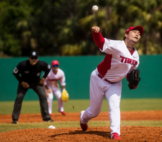 Hong Sang Sam of the Kia Tigers, a professional baseball team from South Korea, pitches at Terry Park in Fort Myers while playing a spring training game against a baseball scouting league team on Tuesday, March 3, 2020. The team is delaying its departure back to South Korea because of the coronavirus. They are scheduled to head back on the 15th but that could change depending on the outbreak.