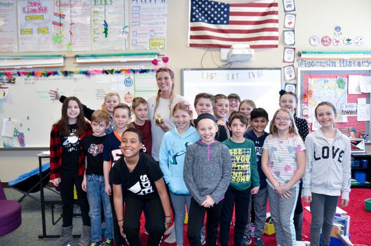 Golden Apple Award winner Amber Kalishek is shown with her students at Bay Harbor Elementary in Suamico.