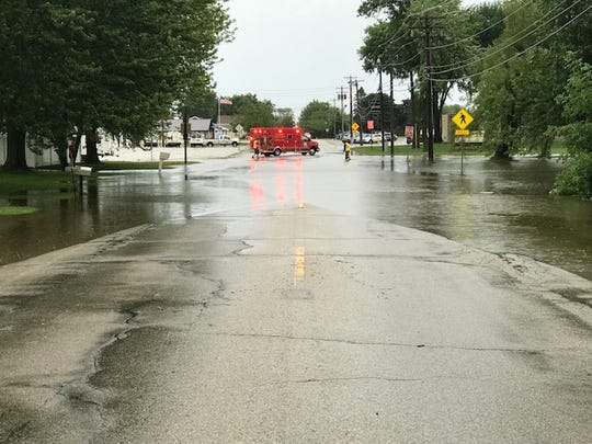The Algoma Fire & Rescue Department pumps water off Jefferson Street after a flood last year in the city.
