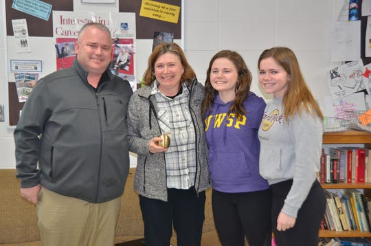 Nicky VanLaanen, center, and family members celebrate her 2020 Golden Apple Award on Feb. 19 at Ashwaubenon High School.