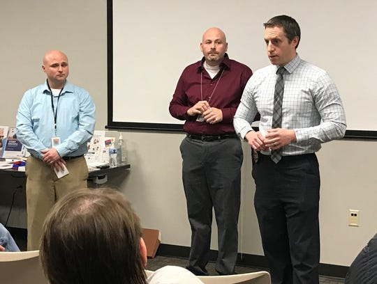 Wisconsin Department of Health Services officials Michael Chase and Scott Timm and Green Bay Police Lt. Matthew VanEgeren speak at a community meeting Monday, March 2, 2020, about sex offender Bruce Brown's release.