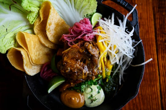 The jezebel pork shank with sweet potato moo shoo, green mango, daikon, redo onion and shiso mayo at Urban Wren Tuesday, March 3, 2020.
