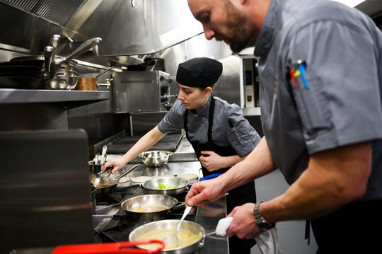 Head chef Taylor Montgomery and sous chef Jess Herter cook in the kitchen at Urban Wren Tuesday, March 3, 2020.