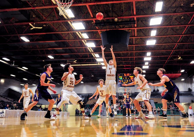 The Belt and Big Sandy boys play in the Northern C Divisional Basketball Tournament challenge game two weeks ago in the Four Seasons Arena. This week's state basketball tournaments will go on as planned, but precautions for the safety of players and fans will be high priority.