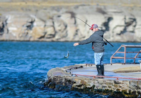 Leon Simpson, who fishes several times a week, pulls out a 10-inch rainbow trout from the Missouri River at Giant Springs State Park March 3.  A winter storm is expected to bury the region under six to 12 inches Friday and Saturday.