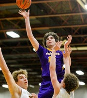 Big Sandy's Clint Darlington shoots in the Northern C Divisional Basketball Tournament challenge game against Belt on Monday in the Four Seasons Arena.