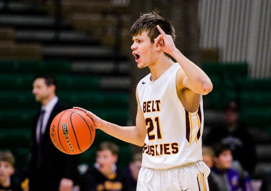 Belt's Hunter Vogl signals a play on offense during the Northern C Divisional Basketball Tournament challenge game against Big Sandy on Monday in the Four Seasons Arena.
