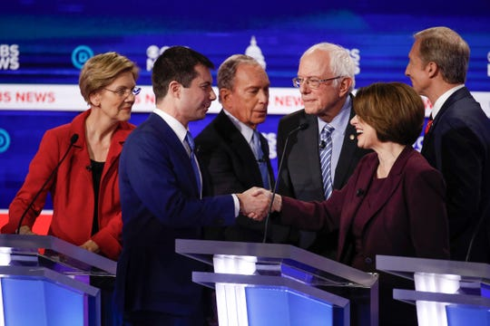 From left, Democratic presidential candidates, Sen. Elizabeth Warren, former South Bend Mayor Pete Buttigieg, former New York City Mayor Mike Bloomberg, Sen. Bernie Sanders, Sen. Amy Klobuchar and businessman Tom Steyer greet one another at the end of the Feb. 25 Democratic presidential primary debate in Charleston, S.C.