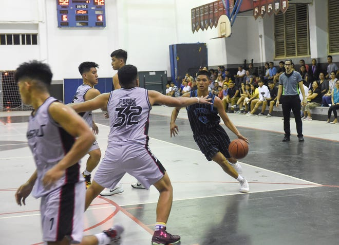 The Simon Sanchez Sharks dominate the Southern High Dolphins 67-50 during an Interscholastic Sports Association Boys' High School Basketball playoff game at the Simon Sanchez High School Gym in Yigo, March 3, 2020.
