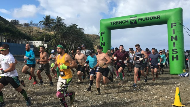 Competitors take off at the start of the inaugural Trench Trail Run 1 held March 1 in Umatac.