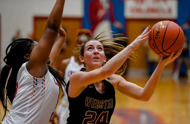Webster County's Adeline McDyer (24) shoots past Christian County's Treliyah Thomas (13) as the Christian County Lady Colonels play the Webster County Lady Trojans at the Second Region Tournament in Hopkinsville Monday evening, March 2, 2020.