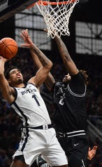 Butler Bulldogs forward Jordan Tucker  (1) takes a shot against Providence Friars center Nate Watson on Feb. 1 at  at Hinkle Fieldhouse  in Indianapolis.