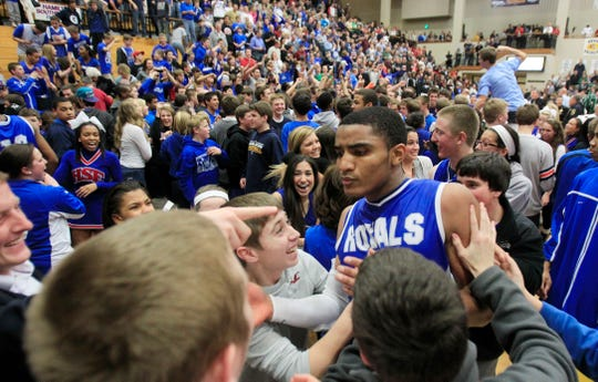 Gary Harris celebrates in a sea of HSE fans after hitting the winning shot at the buzzer to seal a sectional win over the Panthers in the opening round of boys high school sectional play at Noblesville, February 28, 2012.