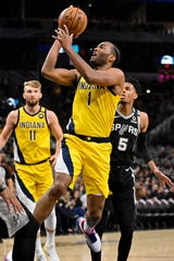 Indiana Pacers' T.J. Warren (1) shoots during the first half of an NBA basketball game against the San Antonio Spurs, Monday, March 2, 2020, in San Antonio. (AP Photo/Darren Abate)