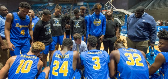 Ripley's coach Tony Tadlock speaks with his team during a timeout in the semifinals of the 4A boys basketball championships in the MHSAA C Spire Basketball Tournament 2020 at the Mississippi Coliseum Monday, March 2, 2020.