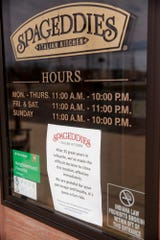 A sign is displayed on the entrance to Spageddies, 3990 South St., announcing the restaurant's closure, Tuesday, March 3, 2020 in Lafayette.