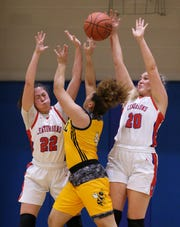 Central's Amaya Asher (4) was defended by Christian Academy's Mia Beam (22) and Alexa Breedlove (20) during their 7th Region Tournament game at Christian Academy in Louisville, Ky. on Mar. 2, 2020.