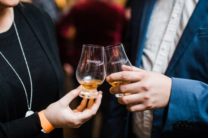 Attendees toast their Pappy at the Bourbon Classic's Top Shelf event.