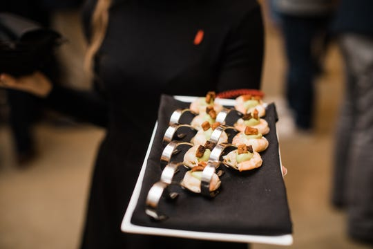 One of Proof on Main chef Jonathan Searle's dishes at the Bourbon Classic event was a pickled Gulf shrimp with avocado mousse and house cured smoked bacon.